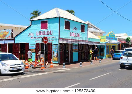 SAINT GILLES LES BAINS, REUNION ISLAND, FRANCE - NOVEMBER 9, 2015: Chez Lou Lou boulangerie is example of creole architecture. Typical retro restaurant in touristic resort on seaside.
