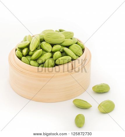 Parkia speciosa seeds or bitter bean in bamboo baskets on white background