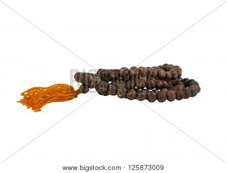 Isolated wooded buddhist rosary against white background