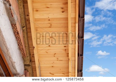 Detail of of roof structure with wooden rafters and insulation layer with tile