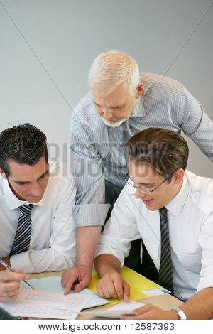 Portrait of a businessmen in suit watching documents