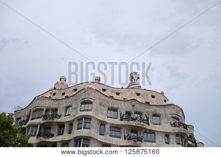 BARCELONA, SPAIN - JULY 31, 2015: Casa Mila or known as La Pedrera, designed by Antoni Gaudi, Barcelona, Spain