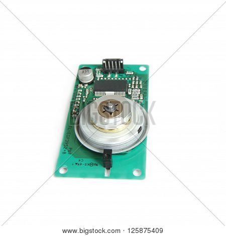 Laser Reflex Electric Motor on Print Circuit Board Isolated on white background