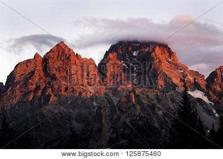 Teton range in Wyoming with clouds and sunset