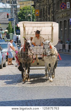 Lviv Ukraine - July 5 2014: Tourist brougham with people on the streets in historic city center