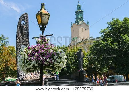 Lviv Ukraine - July 5 2014: People near Shevchenko Monument in historic city center (avenue Prospect Svobody). Taras Shevchenko is greatest poet and the spiritual leader of the Ukrainian nation