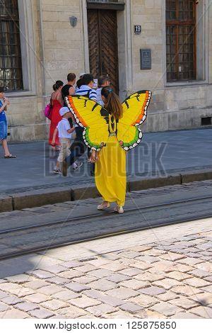 Lviv Ukraine - July 5 2014: Street actor on performing in historic city center (Rynok Square)