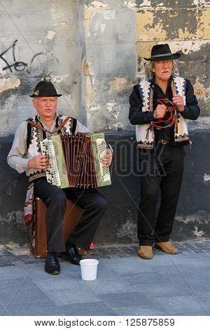 Lviv Ukraine - July 5 2014: Street folk musicians on performing in historic center (Rynok Square)
