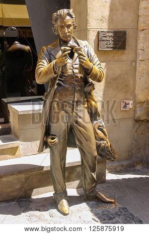 Lviv Ukraine - July 5 2014: Statue of Leopold von Sacher Masoch near entrance of Masoch-cafe in historic city centre