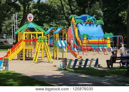 Lviv Ukraine - July 5 2014: People with children on playground in Ivan Franko park