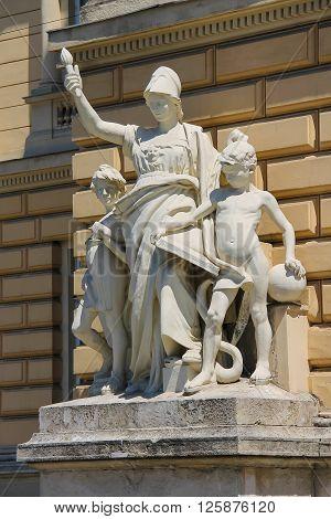 Allegorical sculpture composition Education on facade of Ivan Franko National University main building. Lviv Ukraine