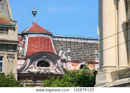 Original roof with angels of old house in historical city center. Lviv Ukraine