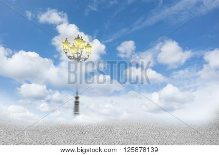 Surreal image of a street lamp in the clouds