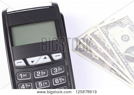 Payment terminal credit card reader and currencies dollar on white background choice between cashless