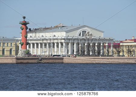 ST. PETERSBURG, RUSSIA - MAY 04, 2015: South Rostral column and stock exchange building on the Spit of Vasilievsky island sunny may day. The landmark of St. Petersburg