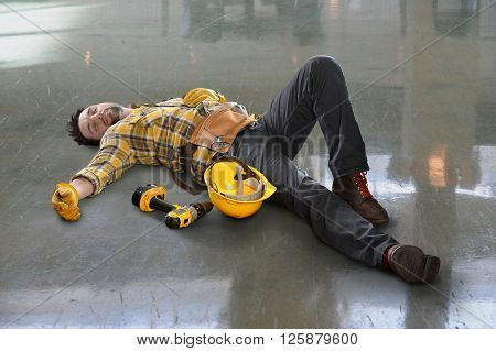 Injured worker laying on floor inside building