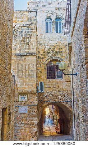 JERUSALEM ISRAEL - FEBRUARY 16 2016: The narrow street with the tiny passage through the house in the maze of the Jewish Quarter on February 16 in Jerusalem