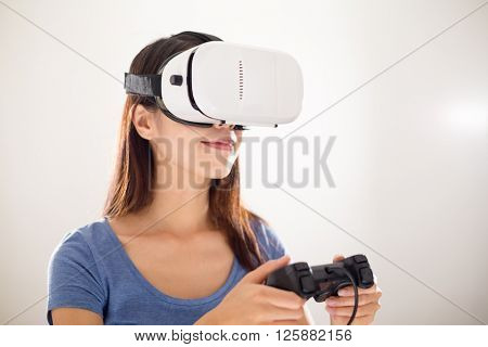 Asian Woman play with joystick and virtual reality device