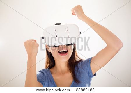 Thrilled Woman wearing virtual reality device