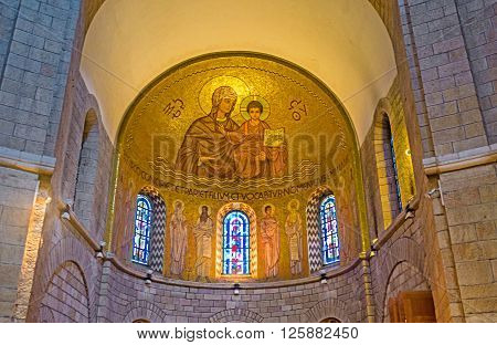 JERUSALEM ISRAEL - FEBRUARY 16 2016: The apse of Dormition Abbey Church is decorated with golden mosaic showing the Mother Mary with Baby Jesus on February 16 in Jerusalem.