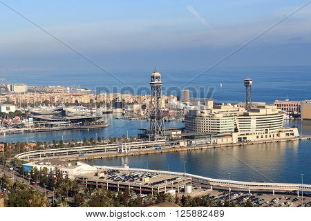 Barcelona, Spain - November 12, 2015: Port Vell Aerial Tramway. It crosses Port Vell, Barcelonas old harbour, connecting the Montjuic hill with the seaside suburb of Barceloneta. The aerial tramway first opened in 1931 and is a tourist attraction.