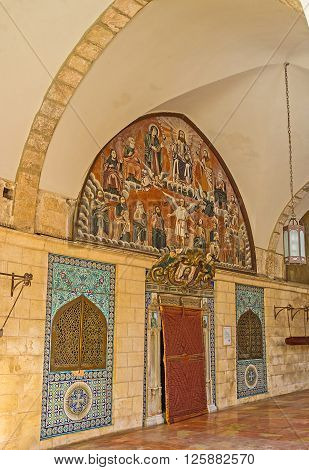 JERUSALEM ISRAEL - FEBRUARY 16 2016: The St James Cathedral in Armenian Quarter boasts beautiful decorations of facade and interior such as traditional religious murals glazed tiles with patterns and metalwork on February 16 in Jerusalem.