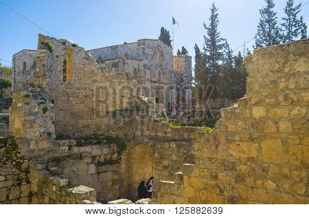 JERUSALE, ISRAEL - FEBRUARY 16, 2016: The ruins of the ancient Byzantine Basilica with the medieval Church of St Anne on the background on February 16 in Jerusalem Israel.