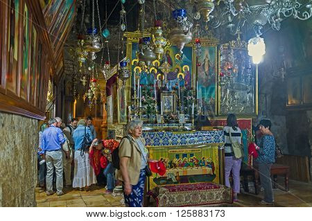 JERUSALEM ISRAEL - FEBRUARY 16 2016: The line of pilgrims to the Edicule of Virgin Mary in Church of the Assumption (Mary's Tomb) on February 16 in Jerusalem
