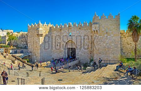 JERUSALEM ISRAEL - FEBRUARY 16 2016: The Damascus Gate is one of the most crowded city exits because behind it hides the local market on February 16 in Jerusalem.