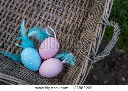 Closeup Of Painted Eggs In Wicker Basket, Top View