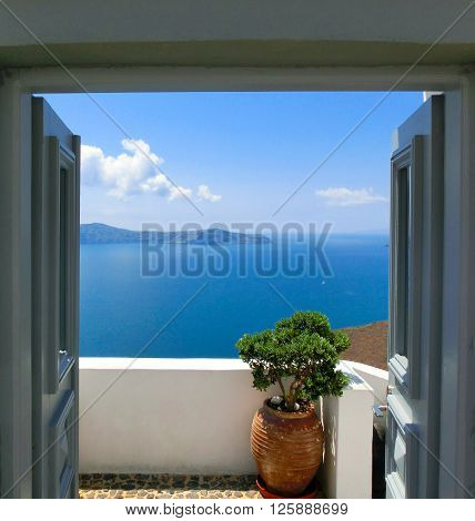 Beautiful sea view from the balcony. Oia town, Santorini island, Greece.