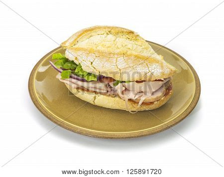 Bread Sandwich Stuffed With Meat Cheese And Vegetables On A Plat