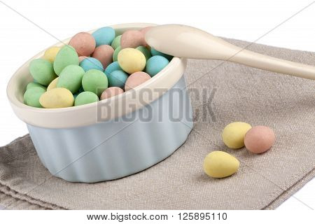 Colorful Eggs In Bowl With Wooden Spoon