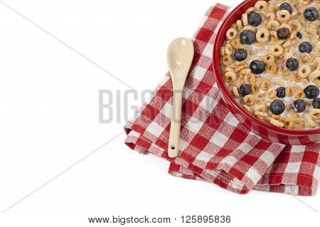 Cropped Image Of Breakfast Bowl With Napkin And Spoon