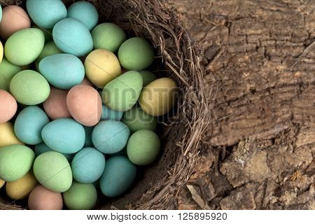 Cropped Image Of Colorful Easter Eggs In A Nest