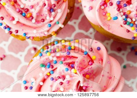 Extreme Close Up Of Strawberry Cupcake With Sugar Icing