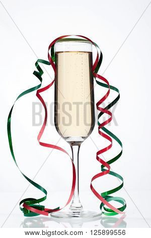 Glass Filled With Champagne With Steamers On It