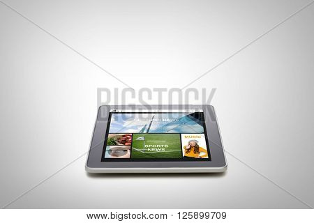 technology, internet, mass media and modern gadget concept - close up of tablet pc computer with news application on screen over gray background