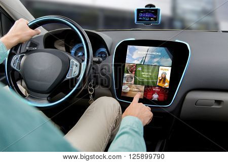 transport, road trip, car driving, technology and people concept - close up of male hand pointing to on-board computer menu
