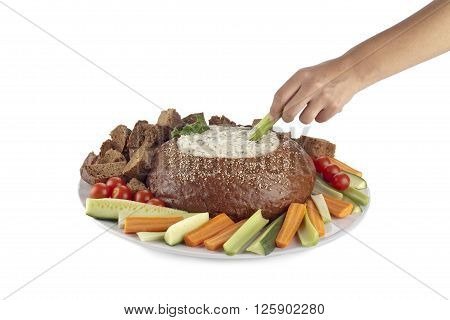 Human Hand Dipping A Slice Of Vegetable On Spinach Dip