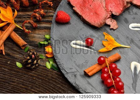 slices of roasted duck breast and garnish