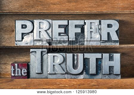 prefer the truth phrase made from metallic letterpress type on wooden tray