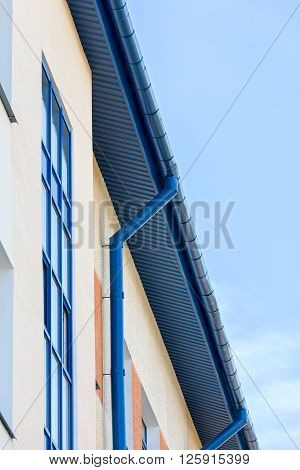 Newly Installed Blue Rain Gutter And Drainpipe