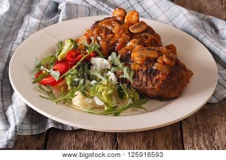 Salisbury Steak With Mushroom Sauce And Vegetable Salad Close-up. Horizontal