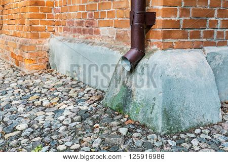 Corner Of Old House With Downspout