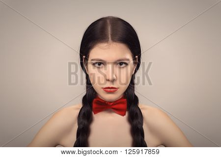 attractive serious girl with long black plait