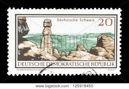 GERMAN DEMOCRATIC REPUBLIC - CIRCA 1966 : Cancelled postage stamp printed by German Democratic Republic, that shows Saxon Switzerland.