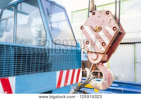 A close up of the hook on a crane.