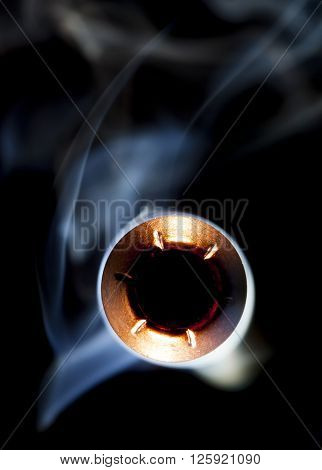 Hollow point bullet with smoke that looks like it is flying close