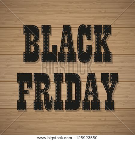 Black Friday text with a shadow on the wooden background